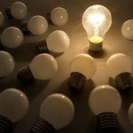 Lightbulbs-only-one-lit-among-several